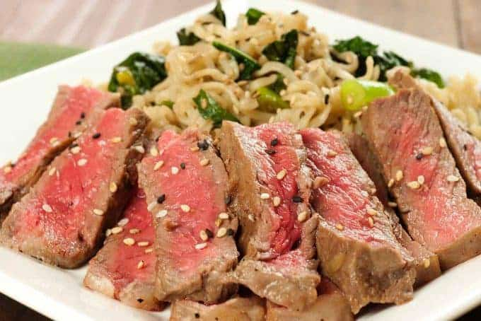 Mirin-Marinated Strip Steaks with Scallion-Kale Ramen