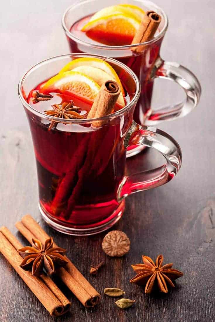 A festive choice for a holiday party, Mulled Wine is a hot wine punch flavored with fragrant mulling spices and fresh oranges. #mulledwine