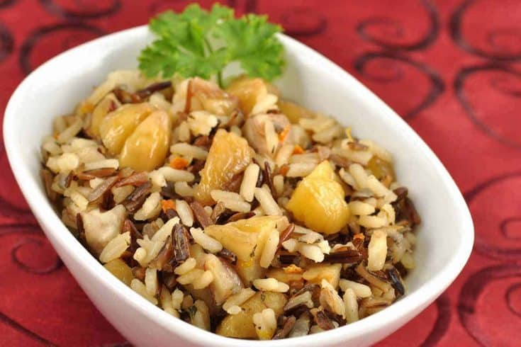 This blend of wild rice, white rice, and chestnuts is a versatile, make-ahead side dish with rich, earthy flavors and a mix of interesting textures. #wildrice #sidedishes #holidaysidedishes #chestnuts