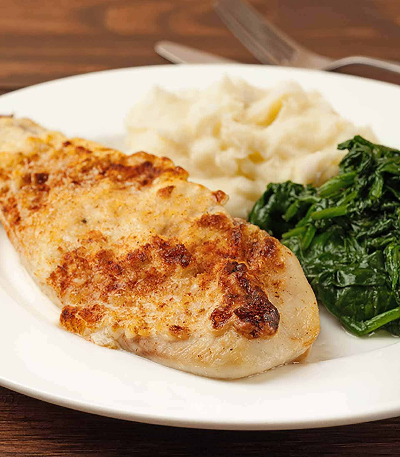 Oven baked fish with caesar topping mygourmetconnection for Oven baked fish recipes
