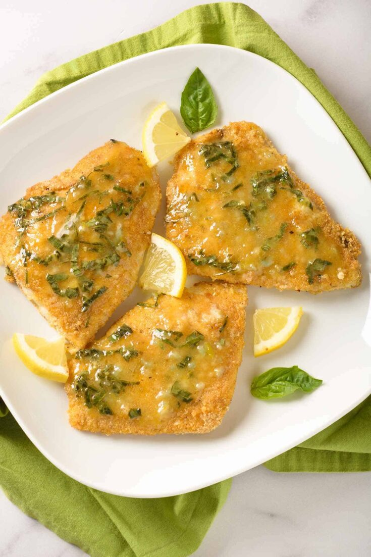 Fresh lemon, basil and butter combine to make a simple, flavorful pan sauce to spoon over crispy, oven-fried fish fillets.