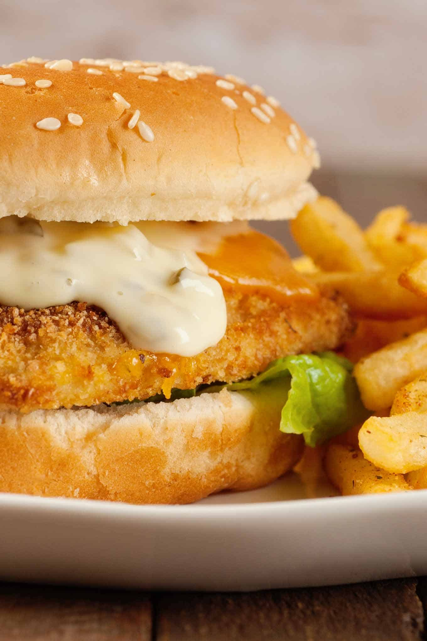 Close-up of oven-fried fish sandwich topped with tartar sauce