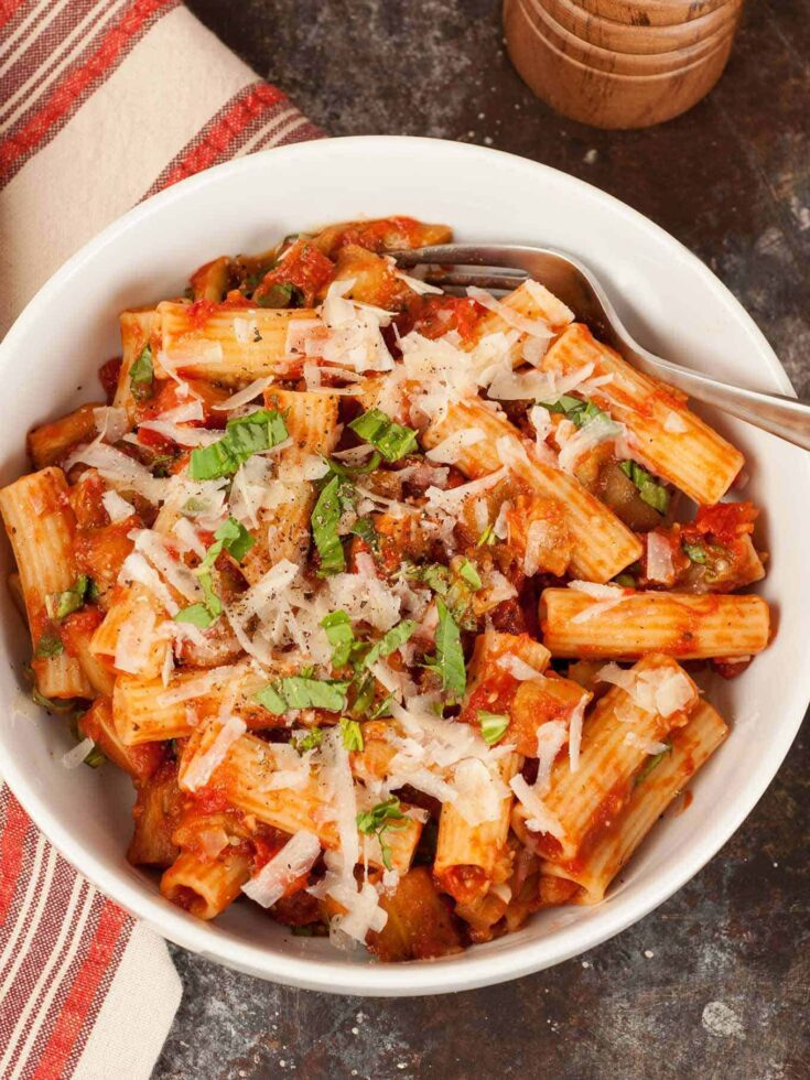 Pasta alla Norma is a simple, yet richly flavored pasta dish from Sicily that combines eggplant, tomato sauce and fresh basil with salted ricotta cheese. #pastaallanorma #pastarecipes #pastawitheggplant #eggplant #ricottasalata