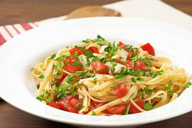 Toss this simple, uncooked sauce of ripe garden tomatoes, basil, parsley and fresh mozzarella with your favorite cut of pasta to make a deliciously satisfying meatless dinner. #pastarecipes #pastawithfreshtomatoes