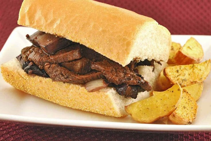 Port wine glazed flank steak, portobello mushrooms, and blue cheese make a deliciously different steak sandwich. #steaksandwiches #steaksandwichrecipes