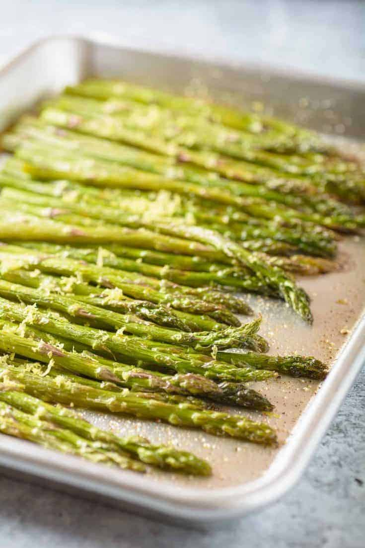 Fresh asparagus roasted in butter and lemon juice makes a deliciously simple side dish that pairs perfectly with dishes like roast chicken or broiled fish. #asparagus #vegetablerecipe