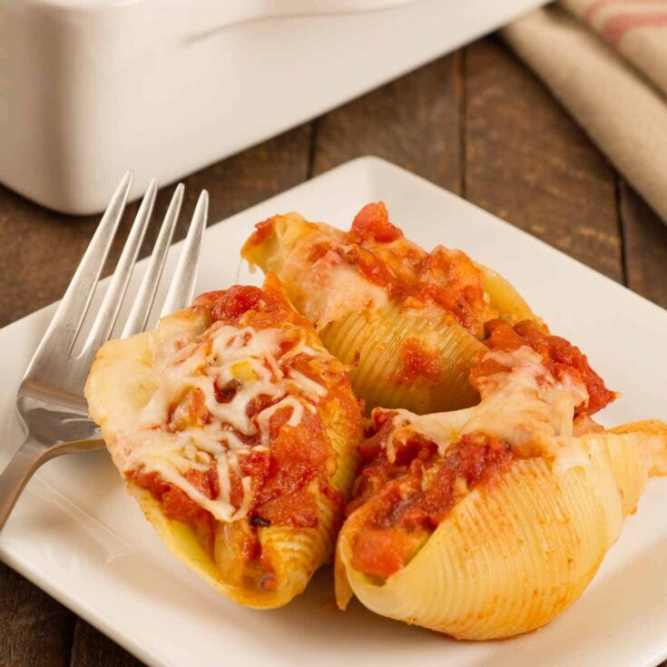 These easy-to-make stuffed shells have a light yet satisfying filling of Italian chicken sausage combined with ricotta and mozzarella cheese. #stuffedshells #stuffedpastashells #sausagestuffedshells