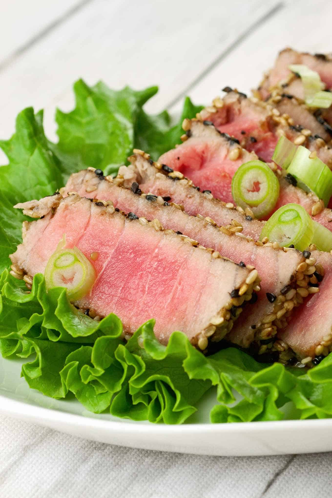Sliced sesame-crusted tuna served over bibb lettuce and garnished with chopped scallions.