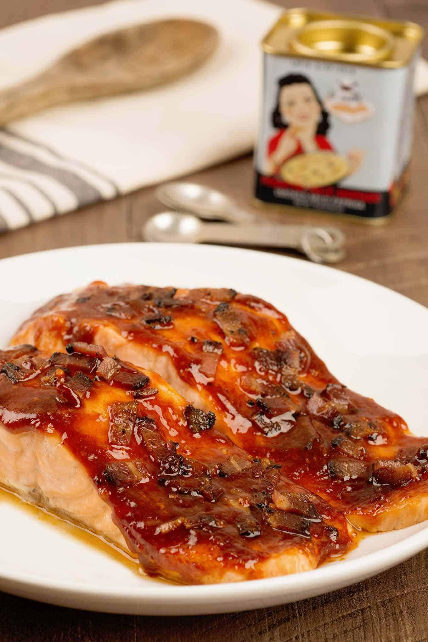 Smoky bacon glazed salmon on serving plate