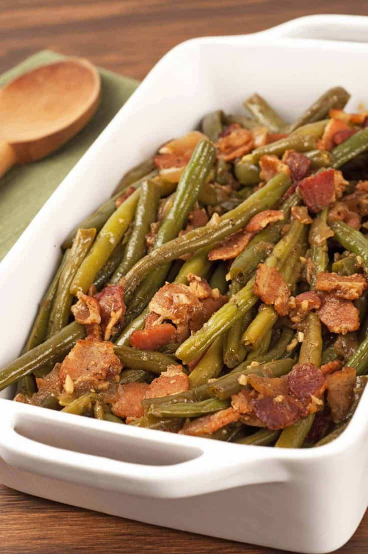 Slow-cooked with smoky bacon and sweet onions, these Southern-style green beans are sure to become a family favorite. #greenbeanrecipes #greenbeans