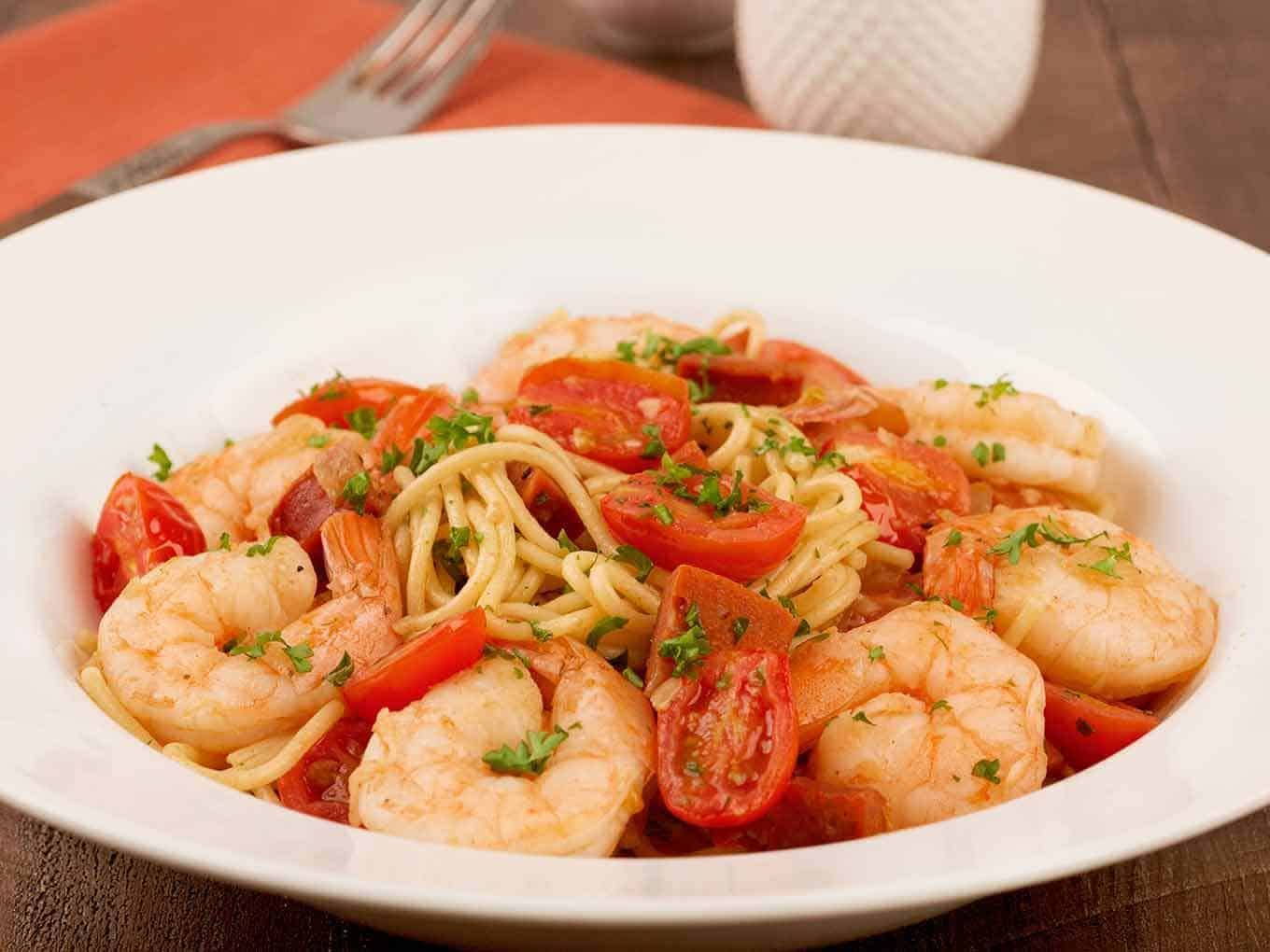 Bowl of spaghetti tossed with sautéed shrimp and diced Spanish chorizo.