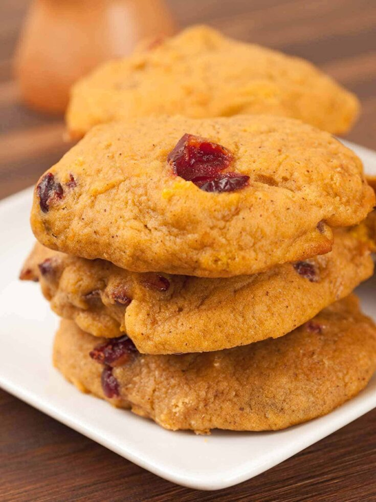 Flavored with orange zest and fragrant spices, these spiced pumpkin and cranberry cookies are a favorite throughout the fall and holiday season. #pumpkincookies #pumpkincranberrycookies #christmascookies
