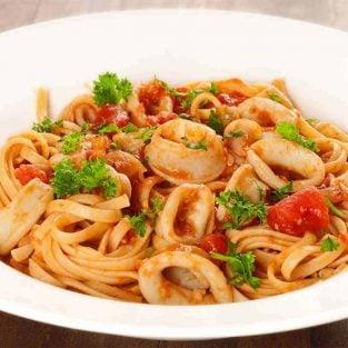 Squid In Marinara Sauce Over Linguine
