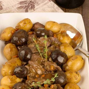 Slow Cooker Pot Roast with Baby Potatoes and Mushrooms