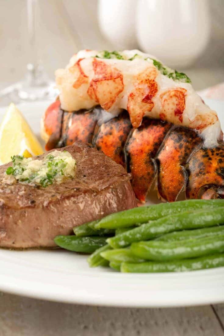 Our easy recipe for surf and turf is focused on timing and ensures that both the filet mignon and lobster tail are cooked to perfection. #surfandturf #lobstertail #lobster #filetmignon #valentinesdaydinner #beeftenderloin #steak #seafood