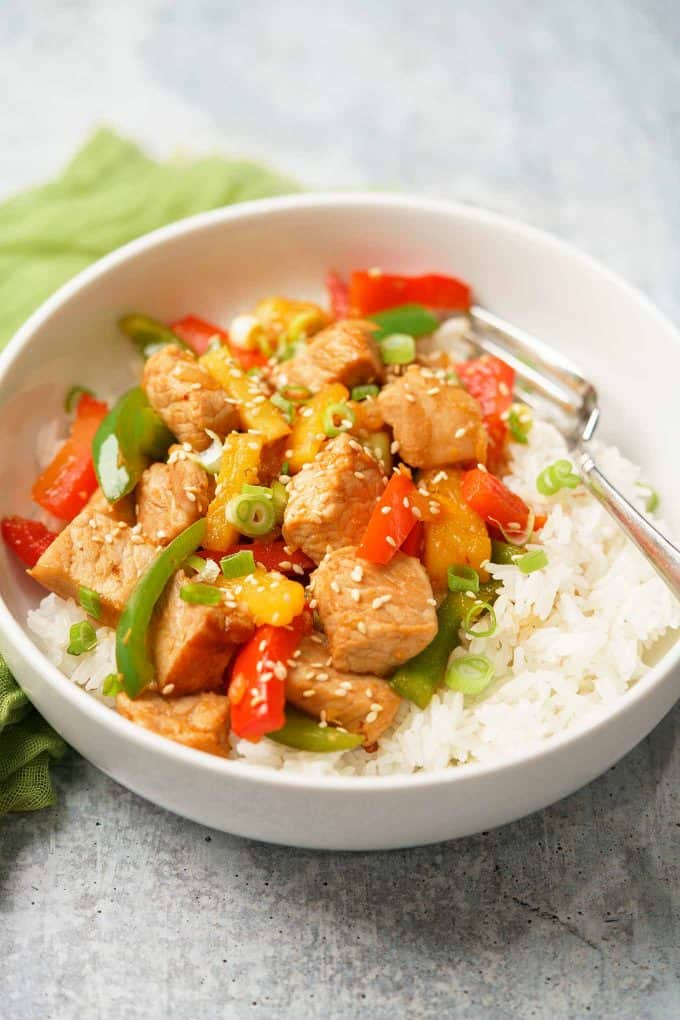 Sweet and sour pork with bell peppers and pineapple over rice