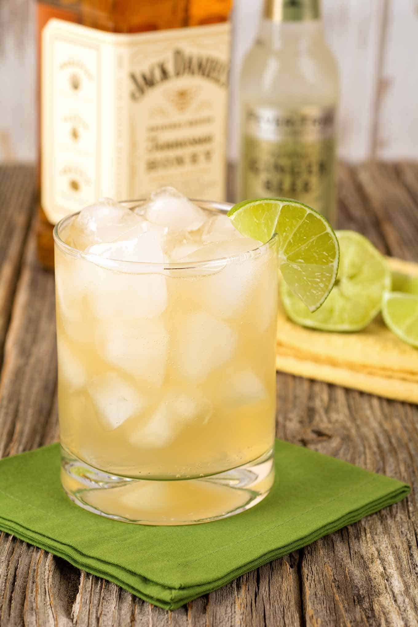 A Tennessee Honey Cocktail in a glass garnished with a lime wedge