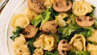 Tortellini with Garlic-Roasted Mushrooms and Sauteed Greens