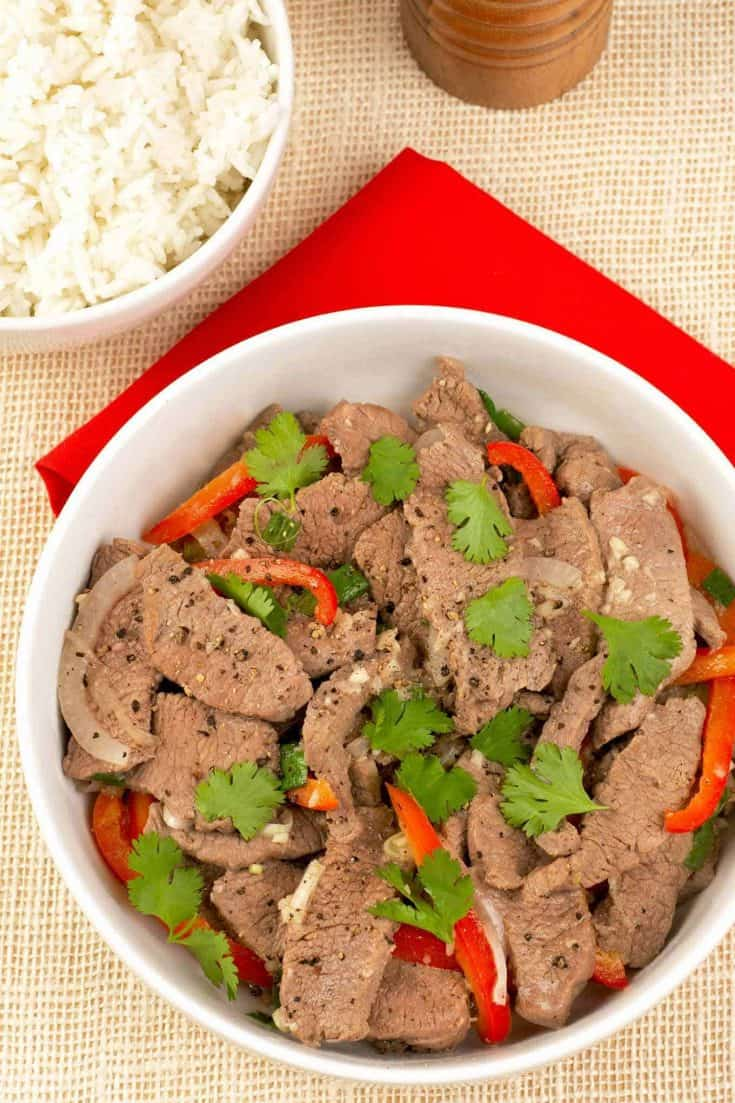This easy Vietnamese-style stir fry goes from kitchen to table in 30 minutes and can be made with various meats including lamb, flank steak or pork. #stirfry #lamb #vietnamesefood