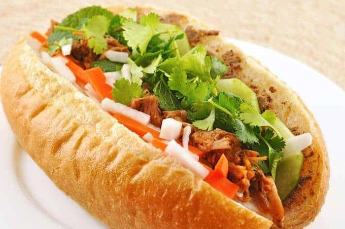 Vietnamese pulled pork sandwich (Banh Mi) on a plate