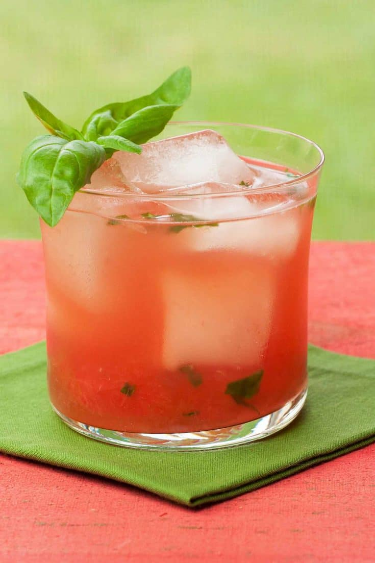 Our watermelon basilito cocktail is a refreshing twist on a traditional mojito made with muddled watermelon, fresh basil, lime and white rum. #rumcocktails #watermeloncocktails