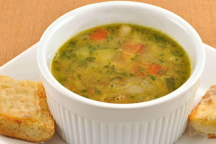 This quick and easy soup is made with cannellini beans, garlic, zucchini, tomatoes, and a pesto-style basil and garlic blend added just before serving for garden-fresh flavor. #soup #cannellinibeans