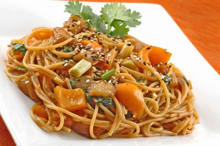 Whole grain thin spaghetti has a nutty taste and firm texture that pairs well with this sweet and spicy and Asian-style eggplant sauce. #eggplant #noodles #maindishes #vegetarian