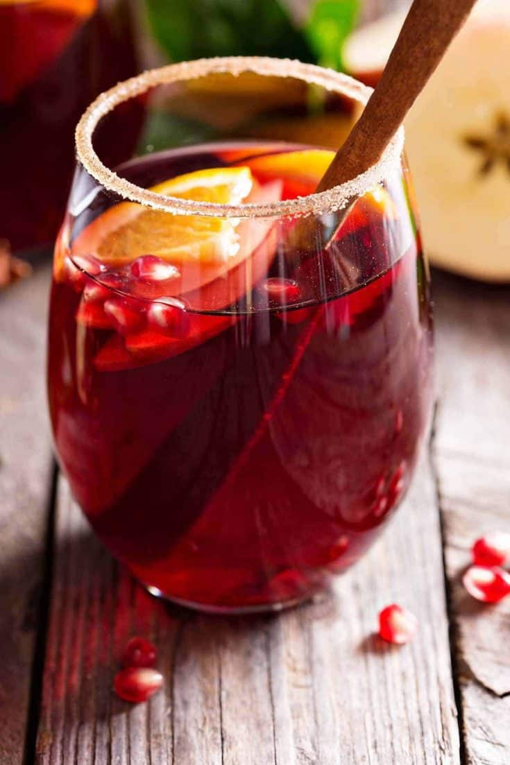 Ruby port, cinnamon schnapps, clementines, cranberries, and spices combine to make a full-bodied, winter sangria filled with seasonal flavor.  #sangria #rubyport