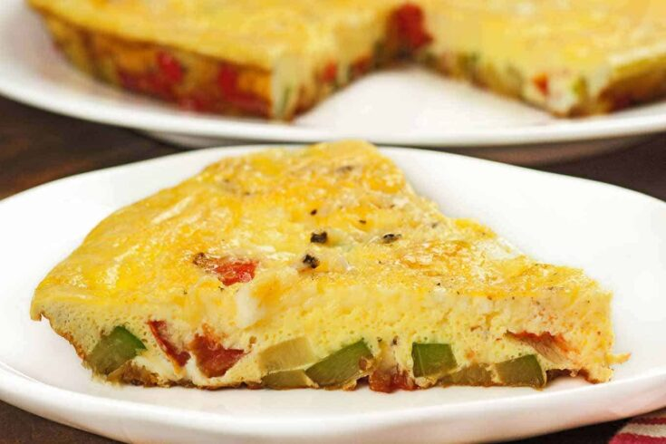 This easy-to-make, meatless frittata combines eggs with zucchini, red bell pepper, tomato, and onion to make an easy meal that's suitable for brunch, lunch or a light supper. #eggs #frittata